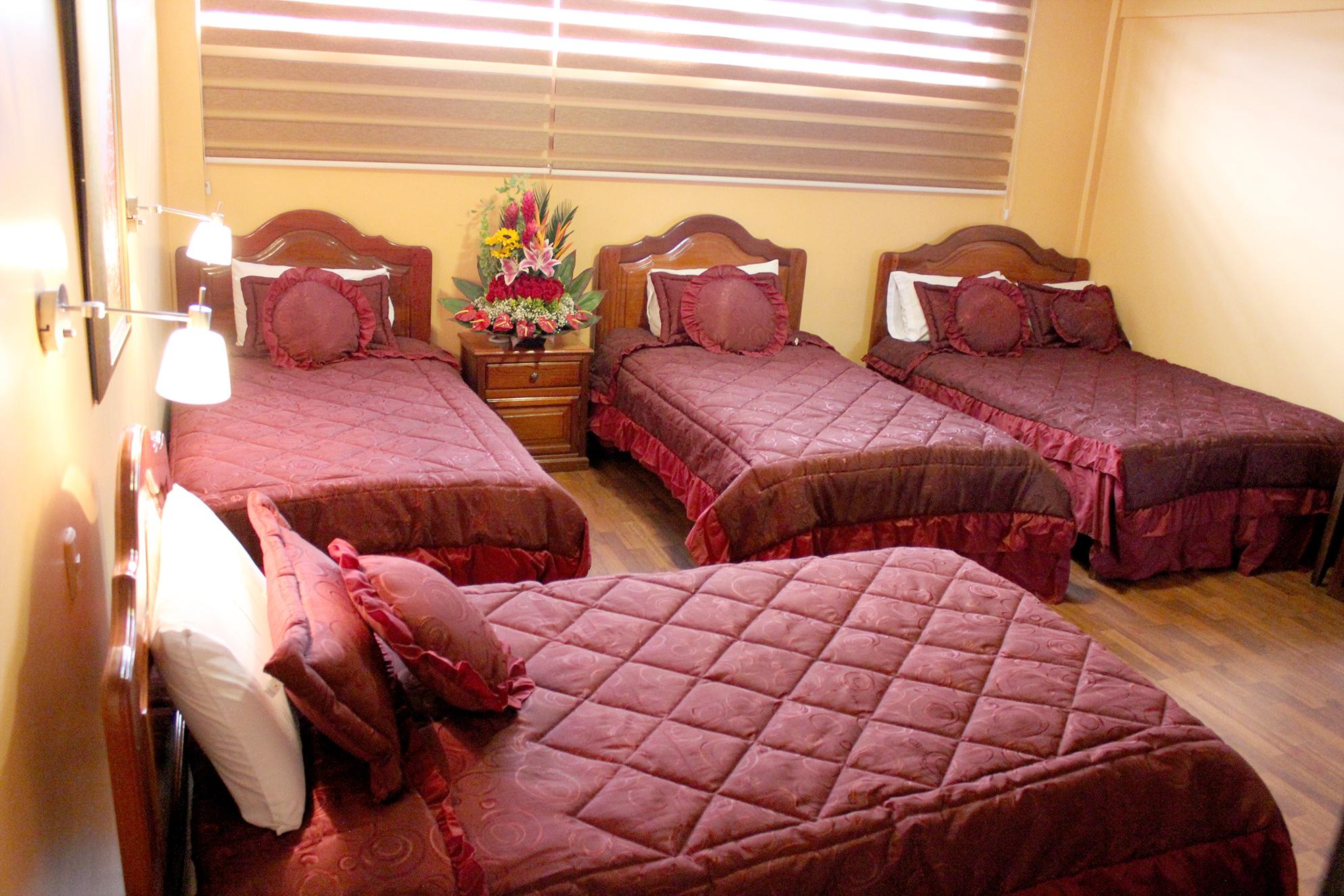 Habitaciones hotel tiwintza for Habitacion quintuple